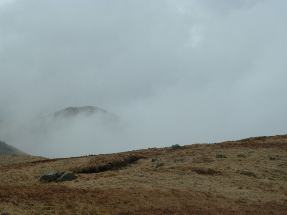 Hills through the cloud
